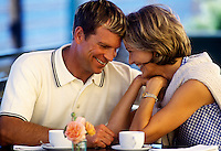 Adult romantic couple at a cafe.