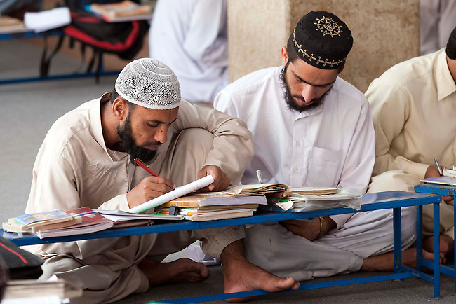 Students at the Jamianaeemia school which is a branch of the Bareldi sect of Sufi Islam in Lahore, Pakistan. The schools principal Sarfraz Ahmed Naeemi is part of an alliance formed by several moderate religious clerics to support the Pakistani Government in its fight against the Taliban in Swat and is teaching its new ideas in the schools.