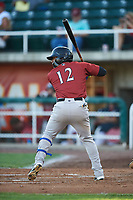 Idaho Falls Chukars Juan Carlos Negret (12) at bat during a Pioneer League game against the Orem Owlz at The Home of the OWLZ on August 13, 2019 in Orem, Utah. Orem defeated Idaho Falls 3-1. (Zachary Lucy/Four Seam Images)