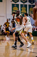 16 March 2019: University of Vermont Catamount Forward Samuel Dingba, a Redshirt Senior from Yaounde, Cameroon, pulls in a first-half rebound during play against the UMBC Retrievers in the America East Championship Game at Patrick Gymnasium in Burlington, Vermont. The Catamounts defeated the Retrievers 66-49, avenging their loss against the same team in last years' Championship Game. Mandatory Credit: Ed Wolfstein Photo *** RAW (NEF) Image File Available ***
