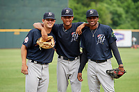 Pulaski Yankees pitcher Alexander Vizcaino (57) poses for a photo with pitcher Justin Wilson (67) and pitcher Luis Gil (35) before a game against the Greeneville Reds on July 27, 2018 at Pioneer Park in Tusculum, Tennessee.  Greeneville defeated Pulaski 3-2.  (Mike Janes/Four Seam Images)