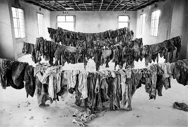 Gikongoro, Rwanda<br /> February 2004<br /> <br /> The clothing of people who died during the 1994 Rwandan genocide on display in a room at the Murambi Technical School, where nearly 50,000 ethnic Tutsis were killed in a period of 2 days. Some of the bodies and clothing were exhumed from the mass graves and placed on public display.