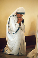 """Calcutta, India. April 04, 1975.<br /> Mother Teresa prays in the morning hours as part of the """"Missionaries of Charity"""" Mother Teresa (Agnes Gonxha Boyaxihu) the Roman Catholic, Albanian nun revered as India's """"Saint of the Slums,"""" was awarded the 1979 Nobel Peace Prize."""