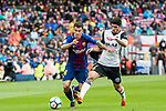 Philippe Coutinho (L) of FC Barcelona fights for the ball with GonCalo Manuel Ganchinho Guedes of Valencia CF during the La Liga 2017-18 match between FC Barcelona and Valencia CF at Camp Nou on 14 April 2018 in Barcelona, Spain. Photo by Vicens Gimenez / Power Sport Images