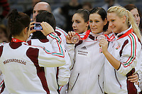 BELGRADE, SERBIA - DECEMBER 16: Anita Gorbicz (C) and Kinga Klivinyi (R) of Hungary posing with medals celebrate with the trophy during the Women's European Handball Championship 2012 medal ceremony at Arena Hall on December 16, 2012 in Belgrade, Serbia. (Photo by Srdjan Stevanovic/Getty Images)