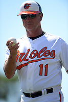 Baltimore Orioles third base coach Bobby Dickerson (11) during a Spring Training game against the Tampa Bay Rays on March 14, 2015 at Ed Smith Stadium in Sarasota, Florida.  Tampa Bay defeated Baltimore 3-2.  (Mike Janes/Four Seam Images)