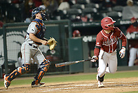 Arkansas pinch hitter Zack Gregory follows through Friday, April 2, 2021, with a two-run, RBI triple during the seventh inning of play against Auburn at Baum-Walker Stadium in Fayetteville. Visit nwaonline.com/210403Daily/ for today's photo gallery. <br /> (NWA Democrat-Gazette/Andy Shupe)