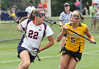 The University of Virginia women's lacrosse player Caroline McTiernan moaves past Townson's Alexa Demski during the first game since the tragic death of Virginia player Yeardley Love Sunday May 16, 2010 at Klockner Stadium in Charlottesville, Va. The Cavaliers rallied in the last four minutes to beat Towson 14-12 and reach the quarter finals of the NCAA tournament. Love's body was found May 3, and Virginia men's lacrosse player George Huguely is charged with murder. Photo/Andrew Shurtleff...