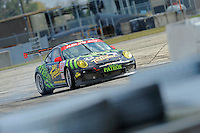 #23 (GTC) Alex Job Racing Porsche 911 GT3 Cup, Jan-Dirk Lueders races into turn 17 too hot and hits the tire barriers.