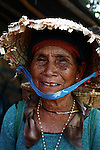 A Bahnar woman smiles for a portrait near the Central Highlands town of Kon Tum, Vietnam. The Bahnar are one of more than two dozen hill tribes known formerly in the West as Montagnards, but who are now called the Dega. April 14, 2012.