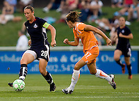 Washington Freedom forward (20) Abby Wambach passes the ball away from Sky Blue FC defender (17) Keeley Dowling at the Maryland SoccerPlex in Boyds, Maryland.  The Washington Freedom defeated Sky Blue FC, 3-1, to secure a place in the playoffs.
