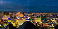Amazing aerial panoramic view of the Las Vegas Strip illuminated at twilight, with the Luxor Excalibur and MGM casinos in the foreground, Las Vegas Nevada