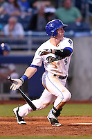Tulsa Drillers outfielder Tyler Massey (5) at bat during a game against the Midland RockHounds on May 30, 2014 at ONEOK Field in Tulsa, Oklahoma.  Tulsa defeated Midland 7-1.  (Mike Janes/Four Seam Images)