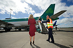 Niall Maloney, Airport Operations Director directs Aoibhin Garrihy, John Burke's wife, towards the plane to meet him on his arrival back to Shannon Airport, following his successful attempt, being the first Clare person ever to climb Mount Everest. Photograph by John Kelly.