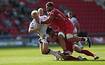 Guiness Pro12<br /> Scarlets pair Rob Evans and Liam Williams haul down Ulster centre Stuart Olding.<br /> Scarlets v Ulster<br /> Parc y Scarlets<br /> <br /> 06.09.14<br /> ©Steve Pope-SPORTINGWALES