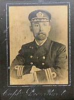 BNPS.co.uk (01202 558833)<br /> Pic: HAldridge/BNPS<br /> <br /> The captain of the Minia William DeCarteret.<br /> <br /> A poignant cross made from drift wood from the Titanic by a seaman tasked with recovering the bodies from the disaster as surfaced 107 years later.<br /> <br /> The small religious symbol was delicately hand carved by Samuel Smith, a joiner on the cable-laying ship Minia which was tasked with searching for bodies.<br /> <br /> Mr Smith was so moved by the macabre experience that he honoured the victims by creating the wooden cross on a three-tiered plinth.<br /> <br /> He made it from a piece of oak wood he plucked from the ocean that has come from the sunken liner.<br /> <br /> The archive is estimated to sell for £35,000 at H Aldridge in Devizes.
