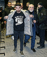 Pictured: Ivan Savvidis (R) the owner of PAOK arrives at Toumba Stadium. Sunday 25 February 2018<br /> Re: Sunday's Greek Super League derby between PAOK Thessaloniki and Olympiakos was called off after Olympiakos' manager Oscar Garcia was struck in the face by an object believed to be a till machine paper roll, thrown by a spectator minutes before kick-off.<br /> Garcia left Toumba Stadium for a local hospital to seek treatment for a bloodied lip.<br /> The incident prompted the Olympiakos team to leave the pitch in protest before riots erupted outside the ground.<br /> Angry PAOK fans leaving the stadium then clashed with police who used tear gas to quell the violence.