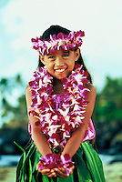 Portrait of a lovely Hawaiian hula girl( age 7) with orchid leis