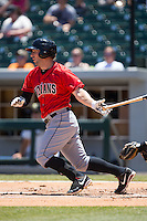 Brent Morel (5) of the Indianapolis Indians follows through on his swing against the Charlotte Knights at BB&T BallPark on June 21, 2015 in Charlotte, North Carolina.  The Knights defeated the Indians 13-1.  (Brian Westerholt/Four Seam Images)