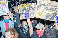 """Thousands gathered outside the Massachusetts State House in Boston, Massachusetts, on Sun., May 31, 2020, to demonstrate against police brutality after the killing by police of George Floyd in Minneapolis, Minnesota, the previous week. Protests, sometimes violent, have erupted around the United States. This protest was organized by an organization called Black Boston. Protesters often chanted """"Black Lives Matter"""" and """"Fuck the police."""" The protest began at 6:30pm in various parts of the city, and around 9pm, after most protesters had left, there began to be clashes between people and police, especially in the Downtown Crossing area of Boston and around Boston Common.  The protest signs here reads """"Asians 4 Black Lives Matter,"""" """"Yellow peril supports black power,"""" and """"Callous, fragile, racist, sexist, nazi POTUS."""""""
