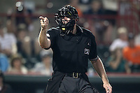 Home plate umpire Jon Saphire makes a call during a game between the Erie Seawolves and Harrisburg Senators at Jerry Uht Park on August 6, 2011 in Erie, Pennsylvania.  Harrisburg defeated Erie 10-6.  (Mike Janes/Four Seam Images)
