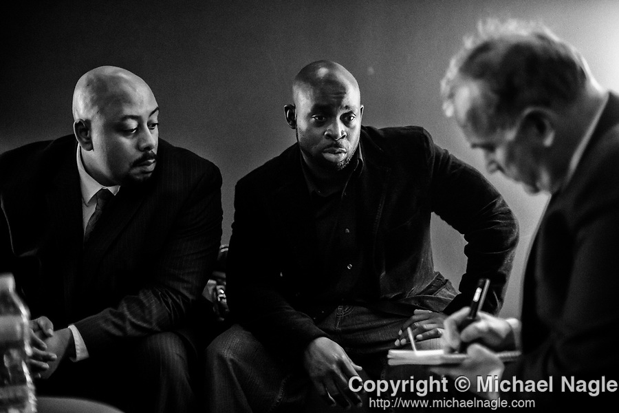 Raymond Santana, left, and Antron McCray, center, are interviewed by Jim Dwyer, columnist for The New York Times, right, backstage at the SVA Theatre before the New York premiere of Ken Burns' Central Park Five documentary on November 15, 2012.  Antron McCray, Raymond Santana, Kevin Richardson, Yusef Salaam, and Korey Wise, all of whom served prison sentences after being wrongly convicted in the Central Park jogger case, had their convictions vacated in 2002, after the confession of Mathias Reyes, who was already serving a life sentence for rape and murder.  Reyes' DNA linked him to the crime.  Photograph by Michael Nagle