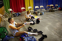 Sarah Doom and Pussy Venom change into their outfits before a roller derby bout in Wilmington, Massachusetts. Roller derby is an American contact sport, popular with young women, which combines both athleticism and a satirical punk third-wave feminism aesthetic.
