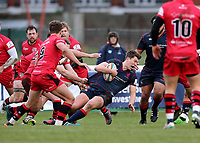 Joe Luca Smith of London Scottish is tackled during the Greene King IPA Championship match between London Scottish Football Club and Jersey at Richmond Athletic Ground, Richmond, United Kingdom on 16 December 2017. Photo by Mark Kerton / PRiME Media Images.