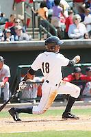 Charleston RiverDogs infielder Abiatal Avelino #18 at bat during a game against the Greenville Drive at Joseph P. Riley Jr. Ballpark  on April 9, 2014 in Charleston, South Carolina. Greenville defeated Charleston 6-3. (Robert Gurganus/Four Seam Images)