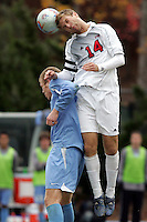 SMU's Jay Needham (14) leaps over UNC's Ben Hunter (left). Southern Methodist University defeated the University of North Carolina 3-2 in double overtime at Fetzer Field in Chapel Hill, North Carolina, Saturday, December 3, 2005.