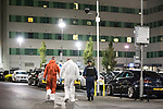 © Joel Goodman - 07973 332324 . 10/08/2017. Salford, UK. Forensic examiners enter a car park at the rear of the Ibis Hotel in Salford Quays where a young boy was killed in a collision with a car earlier this evening (Thursday 10th August 2017) . Photo credit : Joel Goodman