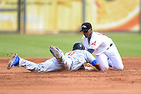 Peoria Javelinas shortstop Francisco Lindor (12) tags out Addison Russell (9) on a pick off throw during an Arizona Fall League game against the Mesa Solar Sox on October 15, 2014 at Surprise Stadium in Surprise, Arizona.  Mesa defeated Peoria 5-2.  (Mike Janes/Four Seam Images)