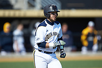 Matthew Oestreicher (20) of the Quinnipiac Bobcats hustles down the first base line against the Radford Highlanders at David F. Couch Ballpark on March 4, 2017 in Winston-Salem, North Carolina. The Highlanders defeated the Bobcats 4-0. (Brian Westerholt/Four Seam Images)
