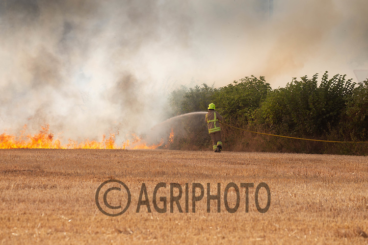 Contractors R & R Mills help Leicestershire fire service bring a field fire under control<br /> ©Tim Scrivener Photographer 07850 303986<br />      ....Covering Agriculture In The UK....