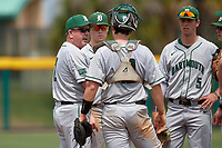 Dartmouth Big Green head coach Bob Whalen (2) talks with catcher Logan Adams (10), third baseman Steffen Torgersen (29) and shortstop Nate Ostmo (5) while making a pitching change during a game against the USF Bulls on March 17, 2019 at USF Baseball Stadium in Tampa, Florida.  USF defeated Dartmouth 4-1.  (Mike Janes/Four Seam Images)