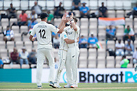 Kyle Jamieson, New Zealand and Neil Wagner, New Zealand congratulate Tim Southee, New Zealand as the `India innings is wrapped up during India vs New Zealand, ICC World Test Championship Final Cricket at The Hampshire Bowl on 23rd June 2021
