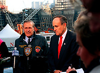 011114-D-9880W-120<br /> Secretary of Defense Donald H. Rumsfeld (left) and New York Mayor Rudolph Giuliani (right) hold a joint media availability at the site of the World Trade Center disaster in lower Manhattan, on Nov. 14, 2001.  Rumsfeld is visiting the site of the Sept. 11th disaster to speak to Giuliani, officials from the N.Y. Fire Department and the Office of Emergency Management.  DoD photo by R. D. Ward.  (Released)