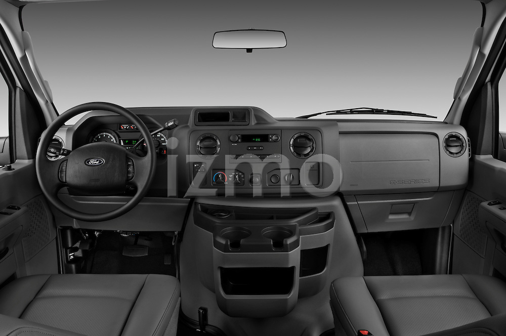 Straight dashboard view of a 2009 Ford E 150 Cargovan.