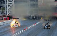 Apr. 1, 2012; Las Vegas, NV, USA: NHRA top fuel dragster driver Clay Millican (left) has a fire alongside David Grubnic during the Summitracing.com Nationals at The Strip in Las Vegas. Mandatory Credit: Mark J. Rebilas-