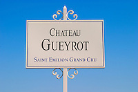 A white sign in the vineyard saying Chateau Gueyrot Saint Emilion Grand Cru Saint Emilion Bordeaux Gironde Aquitaine France