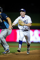 Winston-Salem Dash second baseman Toby Thomas (4) chases Jason Vosler (22) back towards first base at BB&T Ballpark on May 2, 2016 in Winston-Salem, North Carolina.  The Pelicans defeated the Dash 3-2 in 11 innings.  (Brian Westerholt/Four Seam Images)