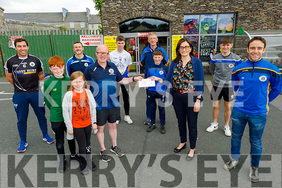 Tralee Parnells GAA club receive €300 from Garveys Supervalu's Tralee store manager Sandra Lynch on Saturday.  Front: l to r: Jack, Caoimhe and Brian Shanahan and Sandra Lynch (Garveys Supervalu) and Andrew Morrissey. . Back l to r: Diarmuid Brennan, David Brick, Darragh Reen, Steven and Donnacha Buttimer and Luke Chester