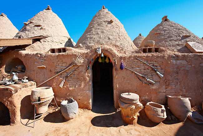 """Pictures of the beehive adobe buildings of Harran, south west Anatolia, Turkey.  Harran was a major ancient city in Upper Mesopotamia whose site is near the modern village of Altınbaşak, Turkey, 24 miles (44 kilometers) southeast of Şanlıurfa. The location is in a district of Şanlıurfa Province that is also named """"Harran"""". Harran is famous for its traditional 'beehive' adobe houses, constructed entirely without wood. The design of these makes them cool inside. 15"""