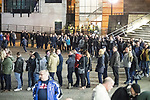 """© Joel Goodman - 07973 332324 . 03/11/2017 . Manchester , UK . Hundreds of fans of Tommy Robinson (real name Stephen Yaxley-Lennon ) queue for a signed copy of the book as anti-fascist counter demonstrators protest at the launch of the former EDL leader's book """" Mohammed's Koran """" at Castlefield Bowl . Originally planned as a ticket-only event at Bowlers Exhibition Centre , the launch was moved at short notice to a public location in the city . Photo credit : Joel Goodman"""