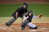 Umpire Ray Parrish and Stetson Hatters catcher Austin Hale (18) await the pitch during a game against the Siena Saints on February 23, 2016 at Melching Field at Conrad Park in DeLand, Florida.  Stetson defeated Siena 5-3.  (Mike Janes/Four Seam Images)