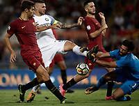 Calcio, Serie A: Roma, stadio Olimpico, 26 agosto, 2017.<br /> Inter's captain Mauro Icardi (c) in action with Roma's Kostas Manolas (r), Federico Fazio (l) and goalkeeper Alisson during the Italian Serie A football match between Roma and Inter at Rome's Olympic stadium, AUGUST 26, 2017.<br /> UPDATE IMAGES PRESS/Isabella Bonotto