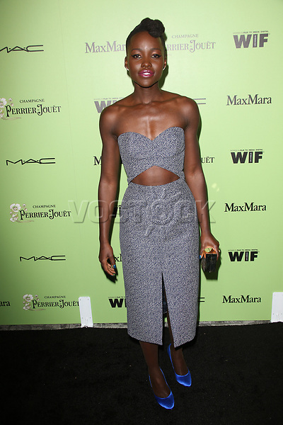 Women In Film Pre-Oscar Cocktail Party Presented By Perrier-Jouet, MAC Cosmetics & MaxMara At Fig & Olive Melrose Place<br /> <br /> Featuring: Lupita Nyong'o<br /> Where: West Hollywood, California, United States<br /> When: 01 Mar 2014<br /> Credit: FayesVision/WENN.com