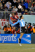 Juan Agudelo (9) of the United States and Javier Zanetti (8) of Argentina. The United States (USA) and Argentina (ARG) played to a 1-1 tie during an international friendly at the New Meadowlands Stadium in East Rutherford, NJ, on March 26, 2011.