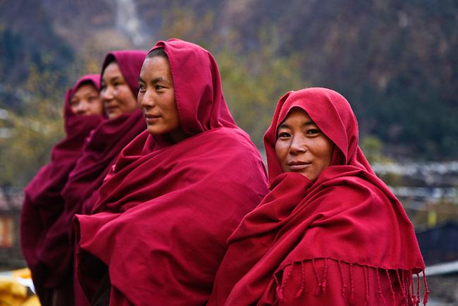 Ningmapa nuns wear traditional robes at a remote TIBETAN BUDDHIST MONASTERY - NEPAL HIMALAYA