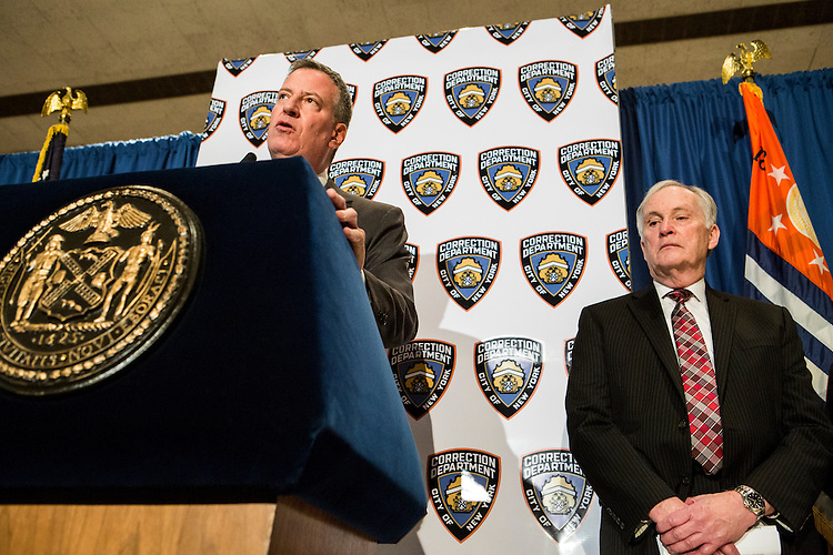 New York City Mayor Bill De Blasio pays a visit to Rikers Island to briefly tour the facilities and lead a press conference on the heel of several reforms being implemented at the facilities by the New York City Department of Correction. Commissioner for New York City's Department of Correction Joe Ponte (right) stands by the mayor during the press conference.<br /> <br /> <br /> Photographed on December 17, 2014 by Mark Abramson for the Wall Street Journal